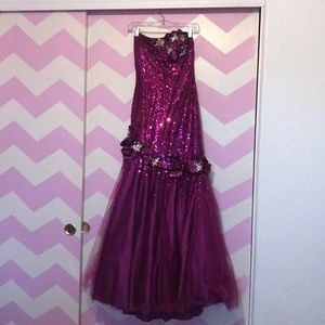 Purple jeweled prom dress. Corset back.
